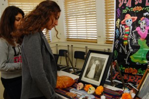 Sophomores Caroline Maroutian and Jennifer Sahakian view the community altar set up for the 5th annual Day of the Dead. Classes set up altars to honor leaders such as President John F. Kennedy Jr., mathematicians such as Sir Isaac Newton and journalists such as Daniel Pearl. Photo by Elizabeth Hovanesian