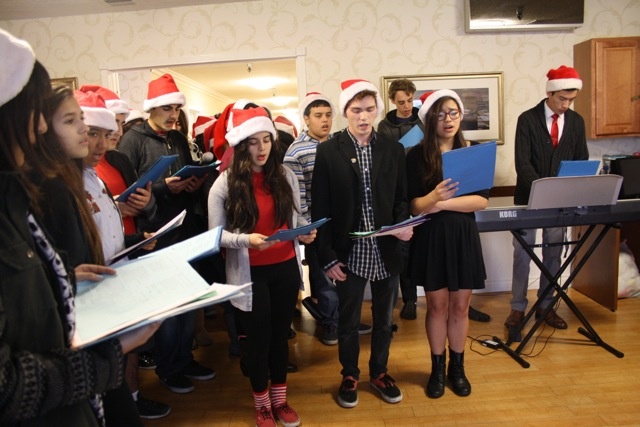 Jackelyn Gorski and her Choir Class perform holiday songs for the elderly at the Lake Balboa Care Center. Photo by Rusel Ramirez